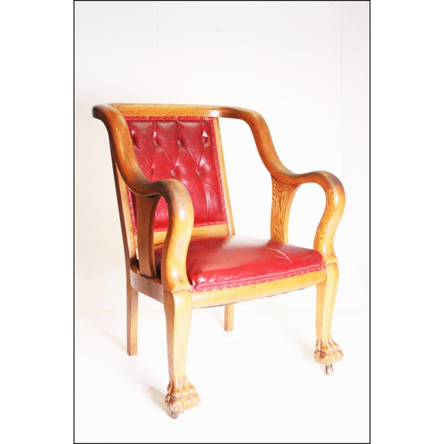 Antique Gentleman's Chair. Nice unique chair made of solid wood with red leather upholstered seat. Wood has beautiful...