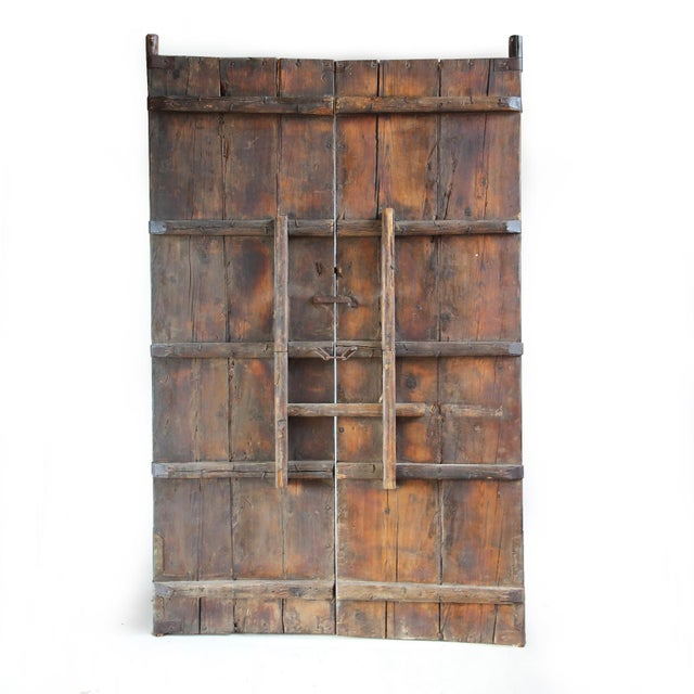 Old elm wood Chinese entry gate with beautiful faded wood patina with original iron work design details. This makes for a...