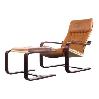 Distressed Lounge Chair and Complimentary Ottoman Attributed for Westnofa, Norway For Sale