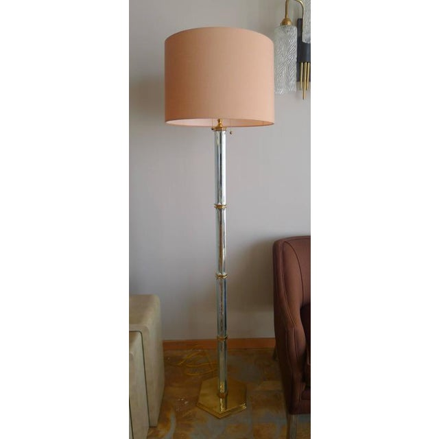 Brass and beveled mirror floor lamp. Limited production, one remaining. Brass is not lacquered so will age naturally,...