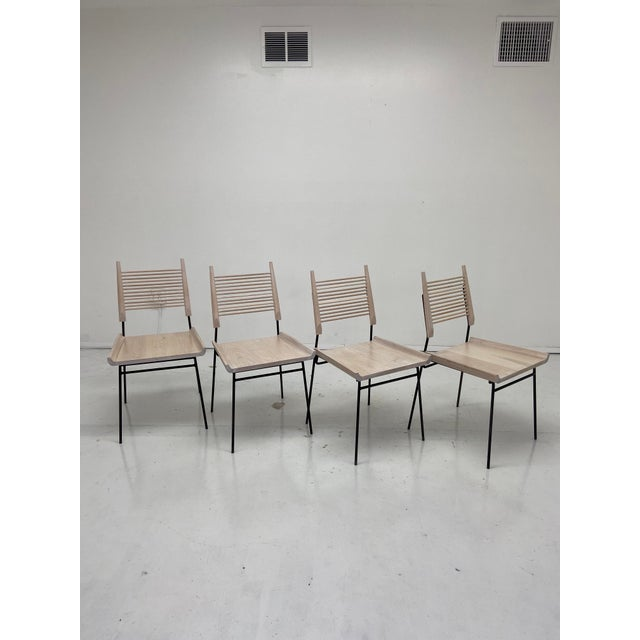 Available is a set of four handcrafted chairs executed in bleached white oak and iron frames. These are handcrafted with...
