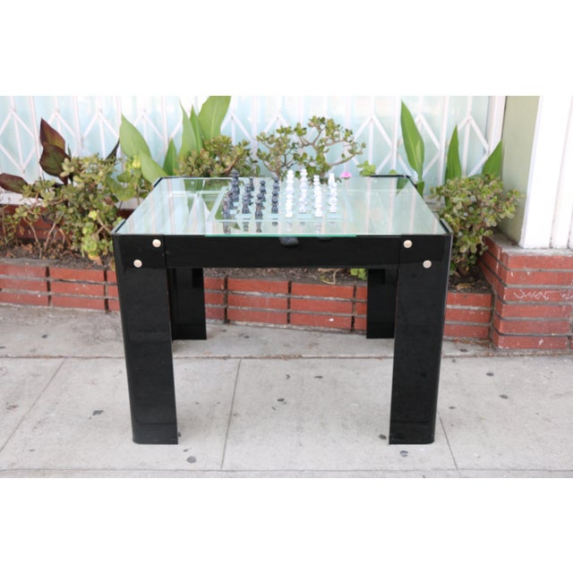 Vintage beautiful well kept backgammon and chest game table in excellent condition. Lucite, glass and brass accent that...
