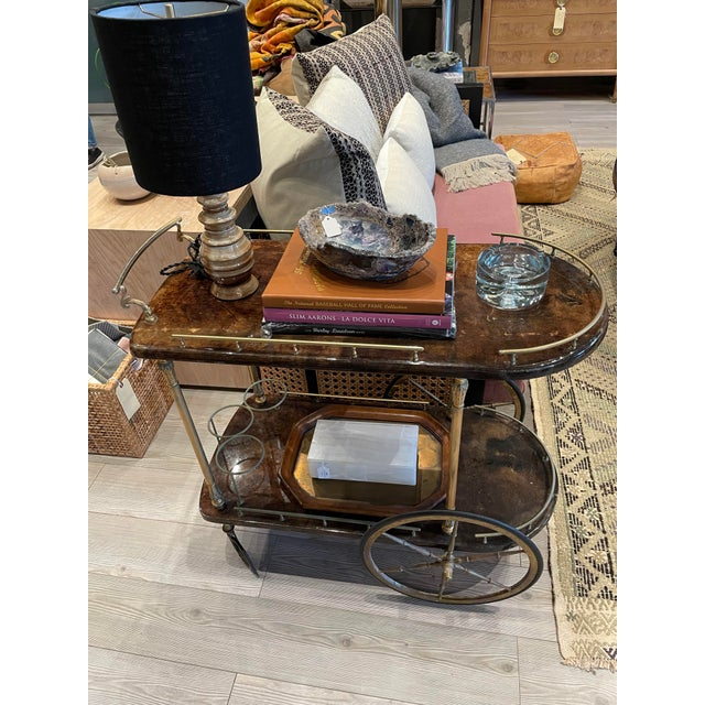 1950s Goatskin Bar cart with Brass details designed by Aldo Tura. This Italian design is a perfect statement piece for a...