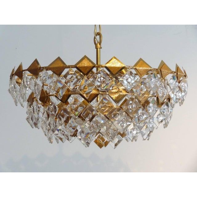 """A gild brass chandelier with multiple faceted glass by Palwa, German circa 1960's measurements dia 22"""" x H 11"""" x over all..."""