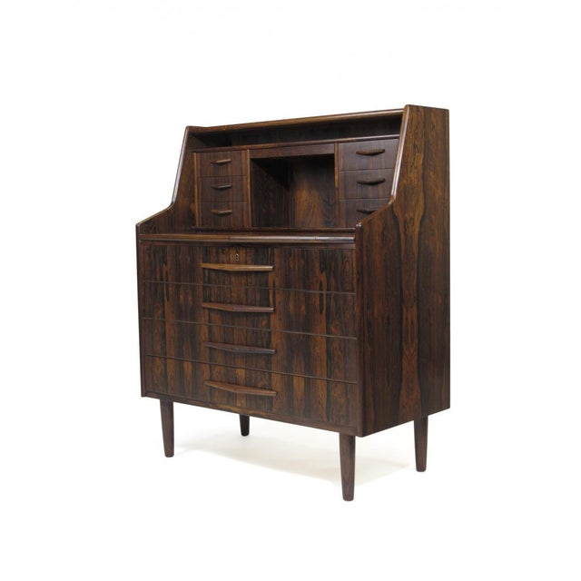 Brazilian rosewood secretary desk with dark grain and dynamic pattern matches across the front of drawers. Six small...
