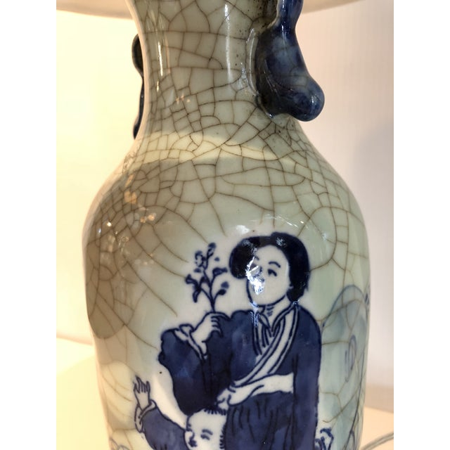 Fine blue and white Chinese export porcelain vase mounted as a lamp on a mahogany base. Included is a new silk off-white...