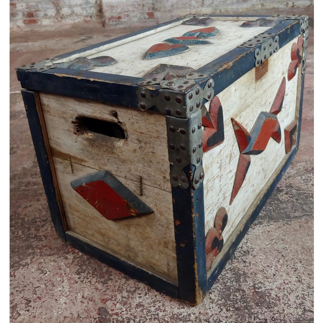 Americana 19th century painted trunk w/poker cards symbols. A beautiful piece that will add to your décor!