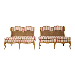 Vintage French Style Hollywood Regency Carved Wood and Cane Settees - A Pair For Sale