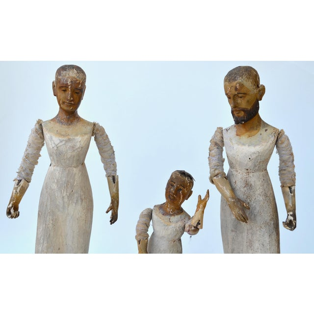 A rare and marvelous trio of the Holy family, articulated Spanish Colonial Santos figures with the original worn painted...