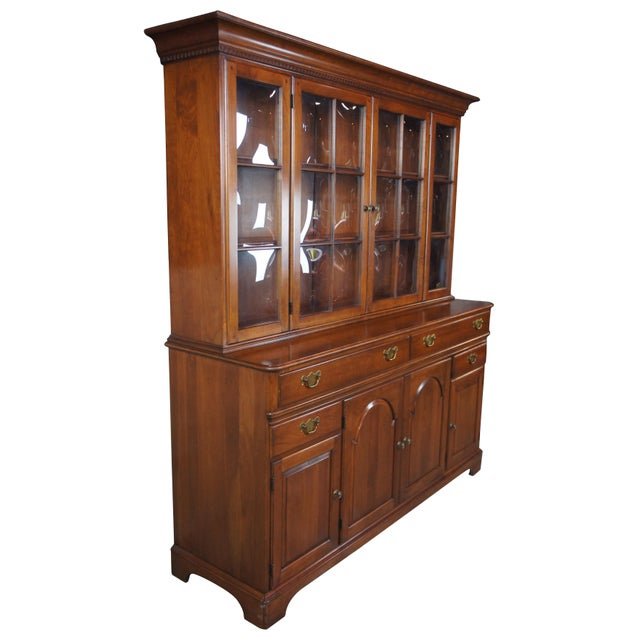 Vintage Pennsylvania House cherry china cabinet and hutch. Features traditional styling, with a bubble glass hutch. Buffet...