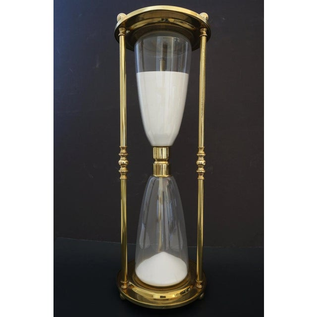 Mid-Century 1-Hour Hourglass Sand Timer in Polished Brass and Hand-Blown Glass from a Palm Beach estate. We have not...