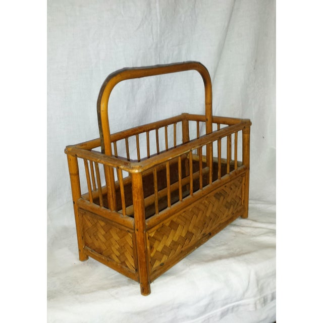 This vintage Bamboo Boho Magazine Rack is from the 1960's. It is excellent condition and strong with no broken areas. It...