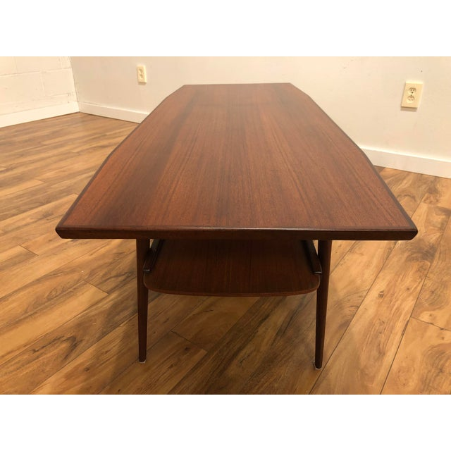Brode Blindheim for Sykkylven mid century modern coffee table with fantastic MCM style. It has great lines, a lower shelf...