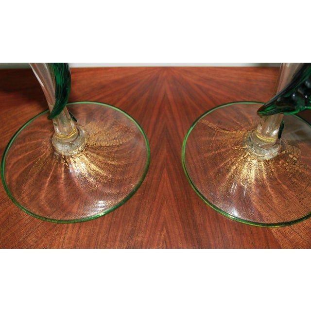 Stunning pair of hand made Murano candle holders with green dragon forms attached and 18 carat gold flecks.