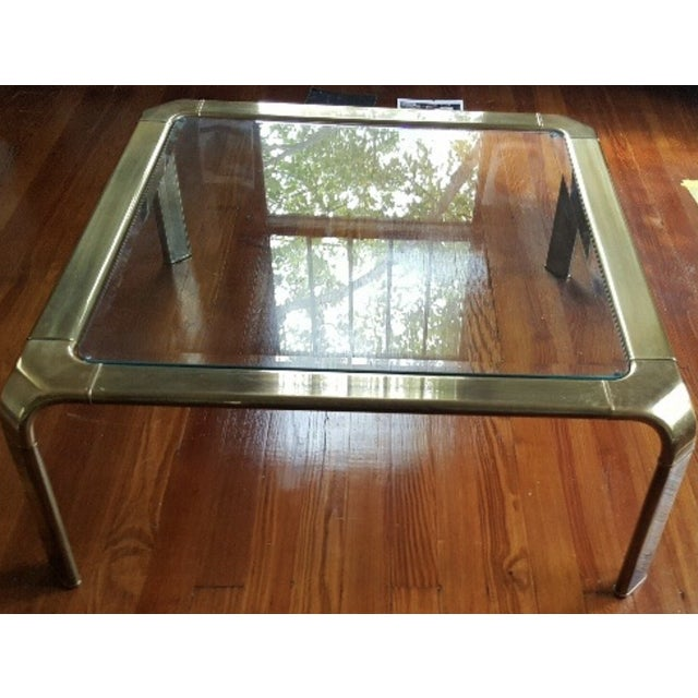 Mastercraft brass cocktail table with glass top.
