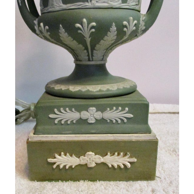 Early twentieth century mountings using a repeat of the plinth motif to heighten the lamps. The urns are in perfect...