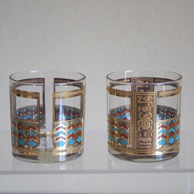 Terrific set of vintage Briard glasses with heavy, gold hieroglyphic applications, accented with rust red and turquoise....