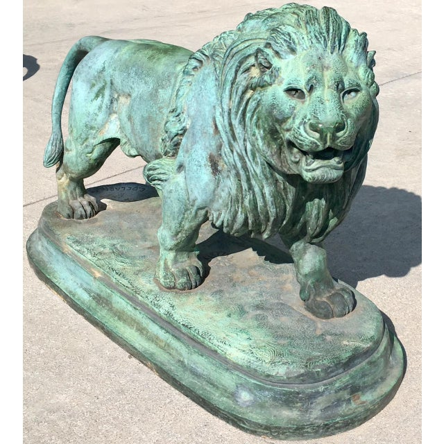 This matching pair of bronze lions by the French sculptor Paul-Edouard Delabrierre circa late 1800's are each signed by...