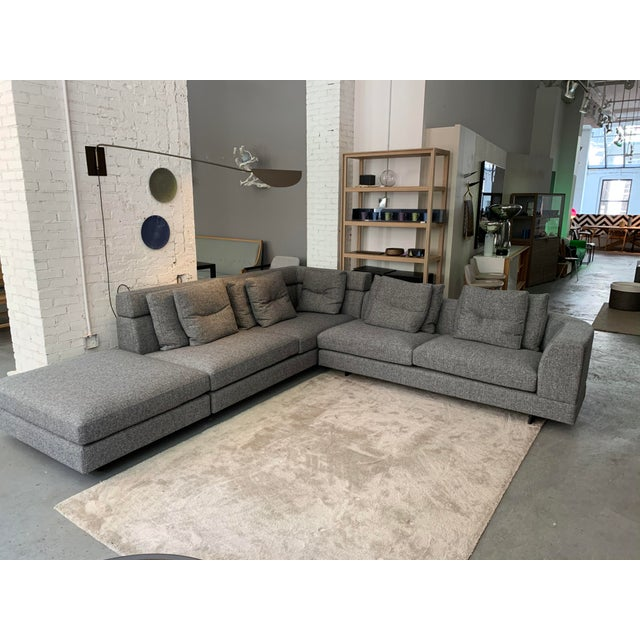 This elegant sectional sofa comes in the charcoal linen/polyester fabric shown. This sofa is designed to be free-floating...