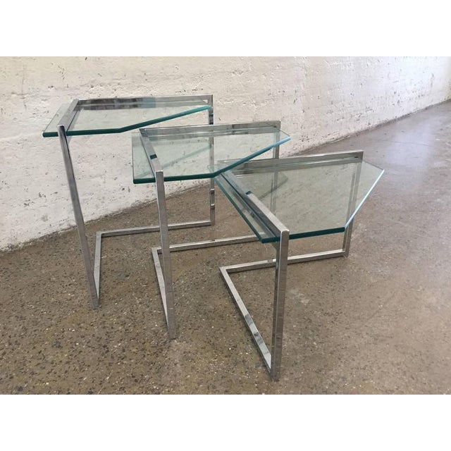 "Milo Baughman Geometric chrome nesting tables with glass tops. Larger table measures: 22.25"" H x 20"" D x 29"" W."