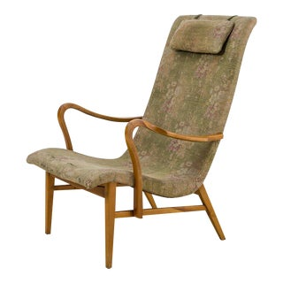 Carl-Axel Acking Lounge Chair with Aged Floral Upholstery, Sweden, 1940s For Sale