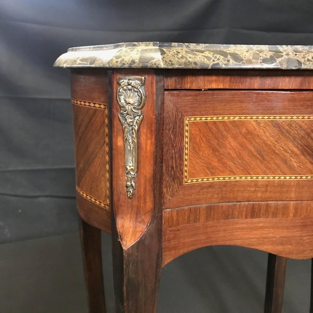 Great looking leggy nightstands, bedside tables or side tables, each with a dovetailed drawer with bronze wreath pull....