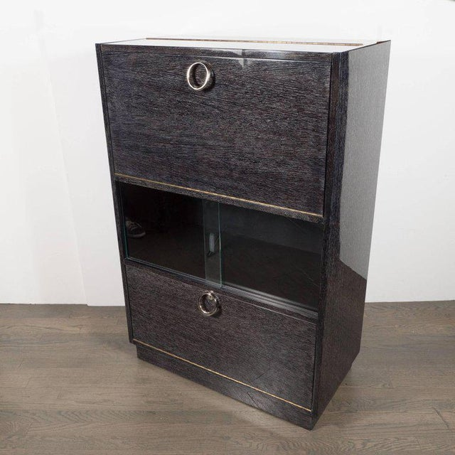 This sophisticated Mid-Century Modern dry bar was handcrafted in silver cerused oak in the United States, circa 1950. The...