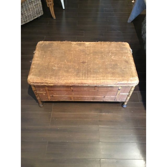 This beautiful scorched bamboo trunk has so much character. The sides and top have woven details and the cut bamboo...
