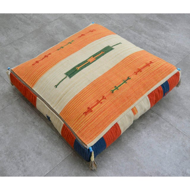 This is a hand woven Turkish kilim floor pillow cover made from a new cotton on cotton hand woven rug. Cushion made with...