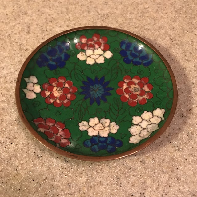 Small tray table with chinese cloisonné and enamel painted in green, pink, blue, and white. The underside of the tray has...