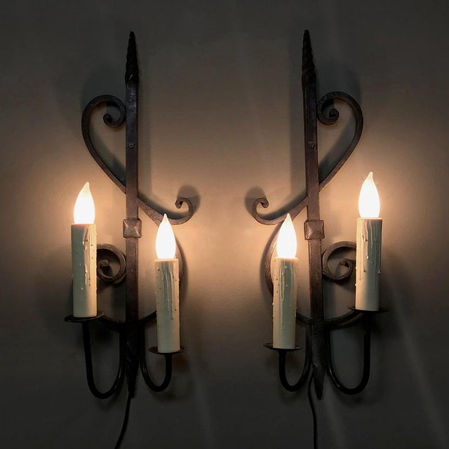 Pair Antique Wrought Iron Wall Sconces have been newly electrified, and were designed in the likeness of a treble clef...