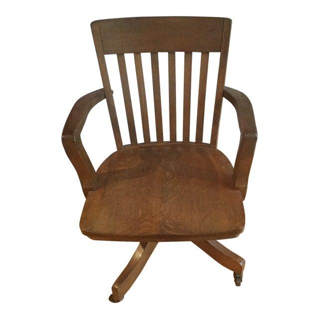 beb5f402fb9d 1900s Vintage Solid Oak Slat Back Swivel Desk Chair For Sale