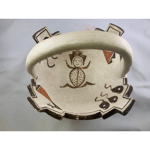 Rare Southwestern Prayer Bowl with Handle featuring traditional designs, signed by Jennie Laate (Zuni, 1933-1994)...