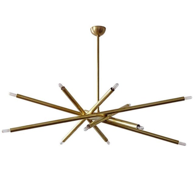 """Stunning oval six-arm, twelve light chandelier in raw brass, diameter: 42""""x24"""", Made to order with a 2-4 week lead time."""