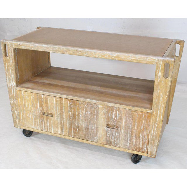 Mid-century modern arts & crafts style ceruised finish solid oak serving drop-leaf bar or cart on wheels. Double door...