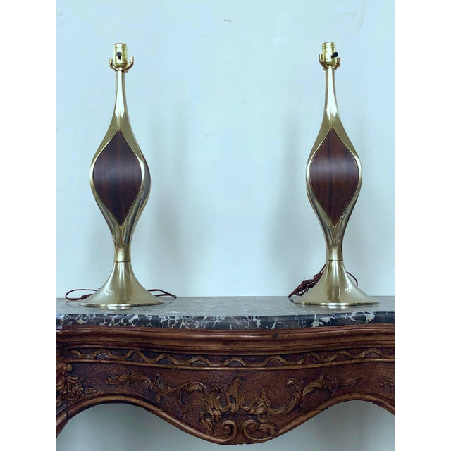 This beautiful pair of modernist Laurel Lamps is cast in solid brass, and inlaid with wood veneer accents on four sides....