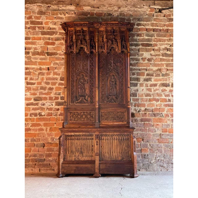 15th century French style Gothic Revival oak cupboard heavily carved, circa 1850 A magnificent, tall and imposing 15th...