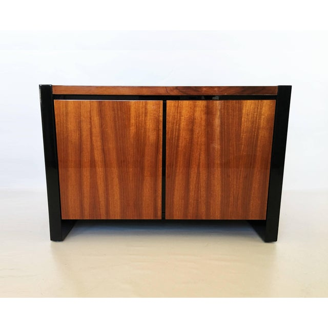 Stunning pair of Henredon Koa wood and black lacquer nightstands or side tables from the Elan Collection by Henredon....