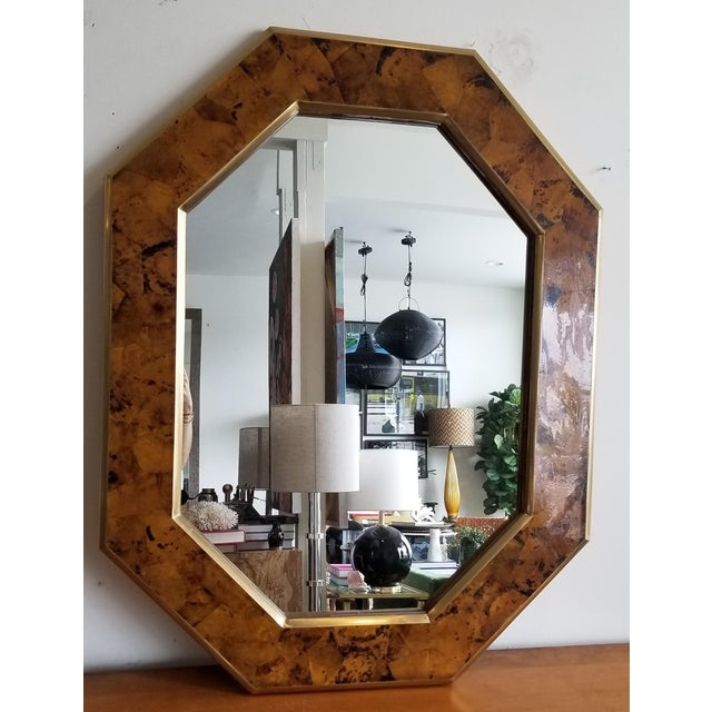 This eye-catching octagonal frame, formed with a young pen shell and brass trim, makes a handsome statement above a...