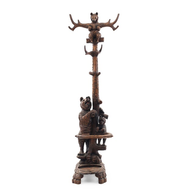 Rustic Black Forest style (20th century) walnut hatrack/umbrella stand with two carved bears on base and one bear in hat...