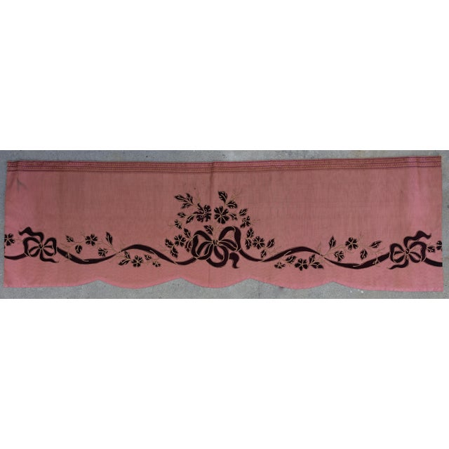 French pink silk moire drapery valance with scalloped bottom edge. Deep burgundy bows and leafy vine run the length of...