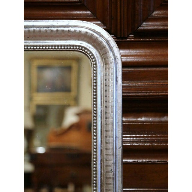 Crafted in the Burgundy region of France, circa 1870, the rectangular wall mirror has traditional, timeless lines with...