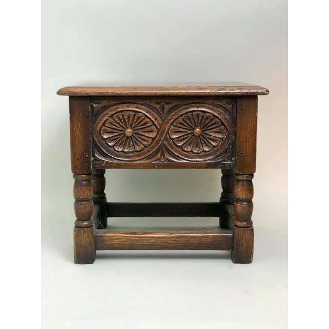 An antique Welsh oak joint stool / bible box with hinged lid. A pegged splayed leg base with stretchers with soften edges....