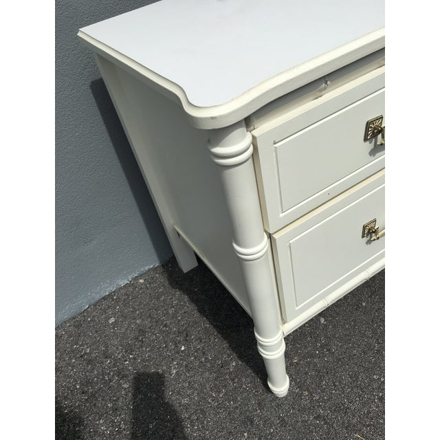 Beautiful faux bamboo nightstand. Very good overall vintage condition. Original finish and hardware. Minor imperfections...