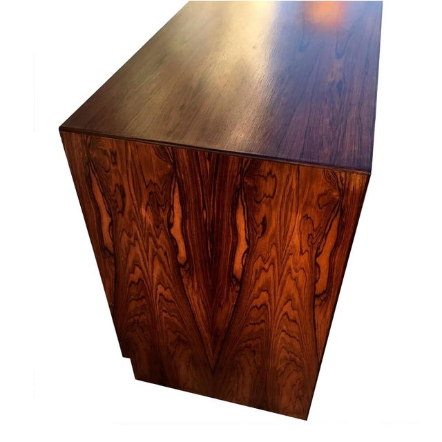 Unique dresser/sideboard from Falster that will complete any room! Brilliant rosewood figuring throughout. It's six...