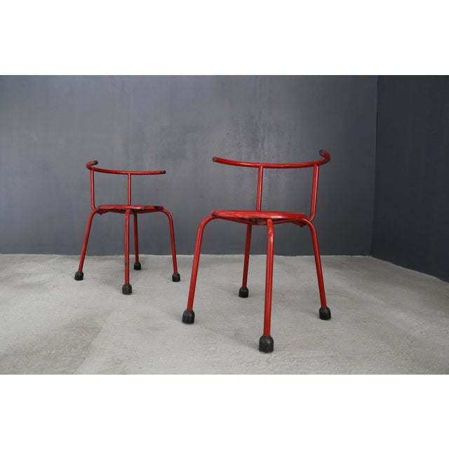 Pair of outdoor chairs by Ettore Sottsass in iron. The seats are in red painted iron. The seat is perforated typical of...