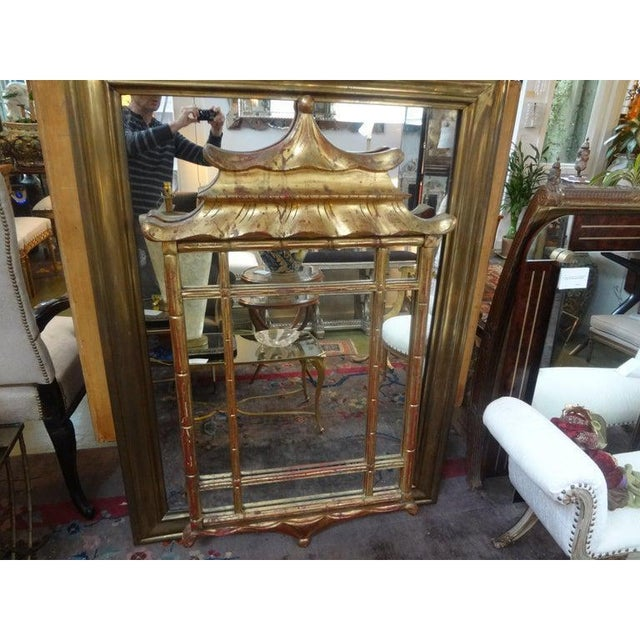 Stunning Italian Chinese Chippendale style gilt wood pagoda style mirror. This beautifully shaped Italian chinoiserie gilt...
