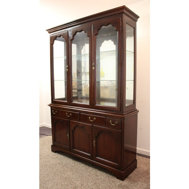 Offered is a nice Drexel Heritage cherry china cabinet from the Carleton collection. The cabinet is two pieces. The piece...