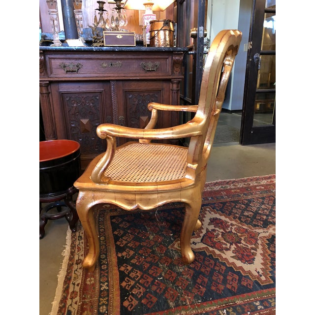 Antique 19th Century Hand Carved Venetian Arm Chair. Made in Italy and professionally refurbished, re-caned and re-gilt....