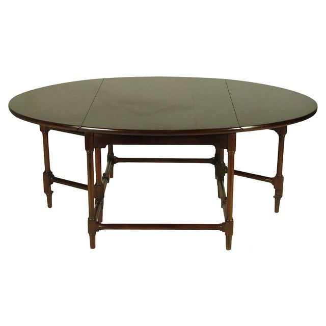 An early 20th-C. Georgian-Style solid mahogany drop-leaf coffee table with hand rubbed lacquer finish by Beacon Hill....